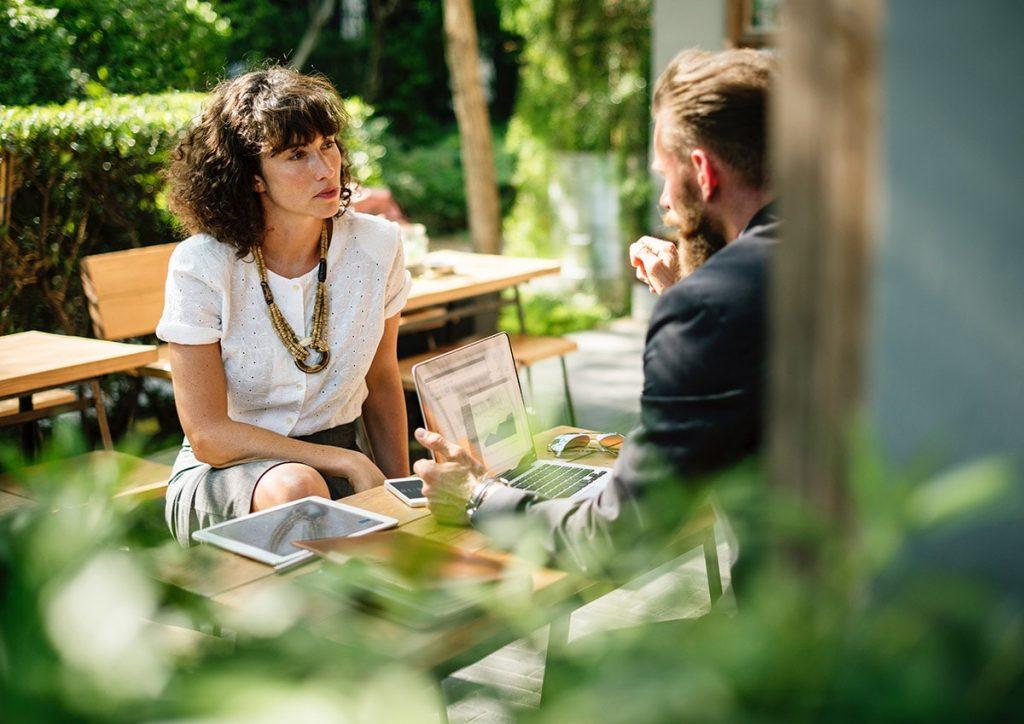 A Woman listening to a Design Mentor